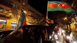 Azerbaidzhanin presidentin Ilham Alijevin kannattajat juhlivat tämän voitettua maan presidentinvaalit.
