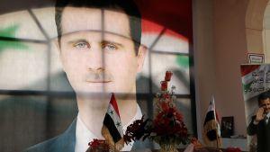 Syyrian presidentti Bashar Al Assad juliste.