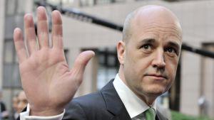 Ruotsin pääministeri Fredrik Reinfeldt kuvattuna saapuessaan Brysseliin 20. maaliskuuta 2014.