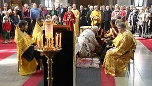 Helsingin metropoliitta Ambrosius pesee Uspenskin katedraalissa 12 papin jalat osana pääsiäisjuhlallisuuksia.