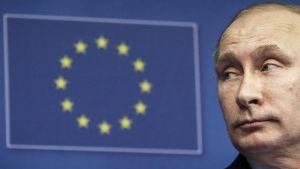 Vladimir Putin ja EU:n symboli.