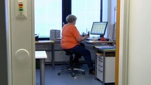 Child protection social worker Pipsa Linnoskivi at work as an office manager despite having retired twice