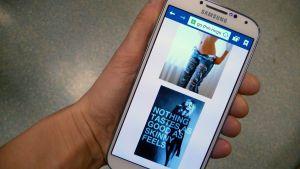 Kädessä matkapuhelin, jossa on auki syömishäiriöitä ihaileva nettisivu