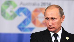 Venäjän presidentti Vladimir Putin vastaamassa toimittajien kysymyksiin G20-kokouksessa Brisbanessa 16. marraskuuta.