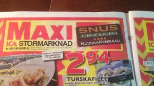 Nuuskakenraali-nimisen liikkeen mainos merilapplaisessa paikallislehti Lounais-Lapissa 16.11.2014.