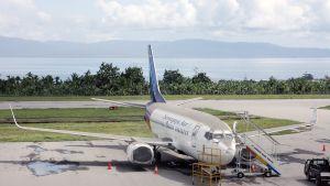 Sriwijaya Airin lentokone peittyi tuhkaan.