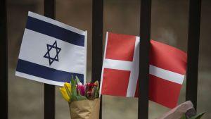Tanskan ja Israelin liput.