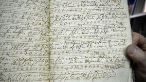 Melchior Vulpiuksen suomeksi käsin jäljennetyt Matteus-passion nuotit 1600-luvulta.