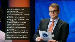 Juha Sipilä puheenjohtajatentissä.