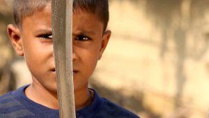 7-vuotiaasta Munapatelista on määrä tulla eläinten teurastaja. Poika haluaisi mieluummin lääkäriksi.
