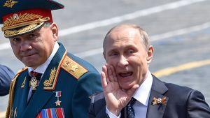 Puolustusministeri Sergei Shoigu ja presidentti Vladimir Putin.