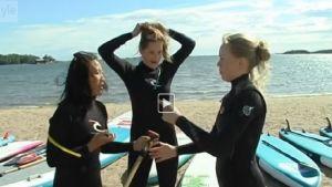 Surfers help clean up a public beach