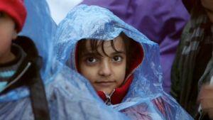 Pakolaisia Kroatian rajalla.