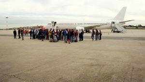 Eritrealaiset turvapaikanhakijat lähdössä Italiasta Suomeen.
