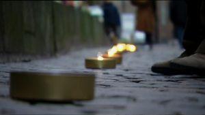 Tanskassa sytytettiin kynttilävana terrori-iskujen muistoksi.