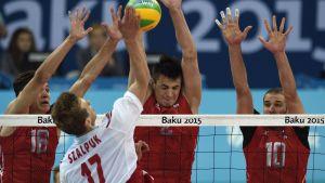 Artur Szalpuk of Poland (2-L) in action against Victor Poletaev (L), IIia Vlasov (2-R) and Alexander Markin (R)