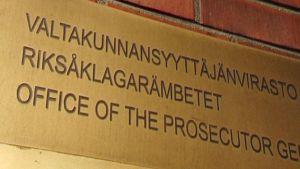 Valtakunnansyyttäjänvirasto -kyltti