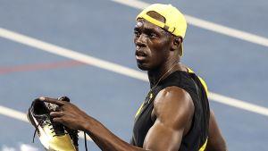 Usain Bolt ja kultaiset kengät.