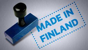 """Leimasin ja teksti """"Made in Finland""""."""