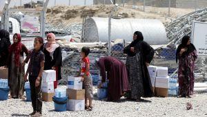 Pakolaisia Dibagan leirillä heinäkuussa.