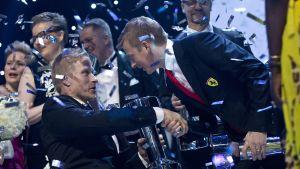 Leo-Pekka Tähti ja Kimi Räikkönen.