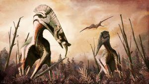 Piirroksuva kolmesta lentoliskosta. Kaksi nielaisemassa pientä dinosaurusta, yksi liitää taivaalla.