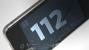112 kännykän näytöllä.