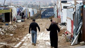 Syyrialaisia pakolaisia Bekaanlaakso leirillä.