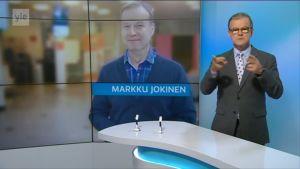 Markku Jokinen uutisläheyksen taustagrafiikassa viittojan vieressä. Otsikko: Markku Jokinen.