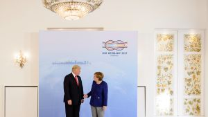 German Chancellor Angela Merkel (R) and US President Donald J. Trump (L) attend their meeting in the Hotel Atlantic one day prior to the G20 summit for bilateral talks in Hamburg, Germany