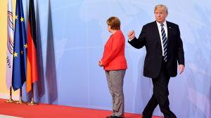 Saksan liittokansleri Angela Merkel ja Yhdysvaltain presidentti Donald Trump kuvattuna G20-kokouksen vastaanottotilaisuudessa Hampurissa 7. heinäkuuta.