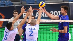 Russia's Artem Volvich (R) and Slovenia's Alen Sket (L) and Alen Pajenek (C) in action during the 2017 CEV Volleyball European Championship