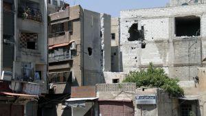 Vaurioituneita rakennuksia Damaskoksessa.