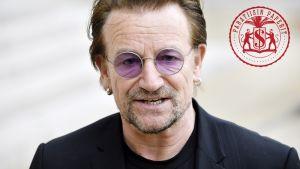 Bono vaaleanpunaisissa, pyöreissä silmälaseissaan.