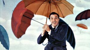 Laulavat sadepisarat (Singin' in the Rain). Kuvassa Gene Kelly.