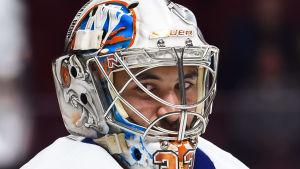 Christopher Gibson i New York Islanders färger.
