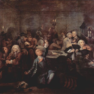 """""""Peliluola"""" (nro 6). Ollaan White's Clubilla Sohossa. Peruukiton Tom on juuri pelannut toisen omaisuutensa ja kiroaa kohtaloaan. Kaksi krupieeria taka-alalla on huomannut seinäpaneeleissa alkavan tulipalon. William Hogarthin maalaus 1730-luvulta."""