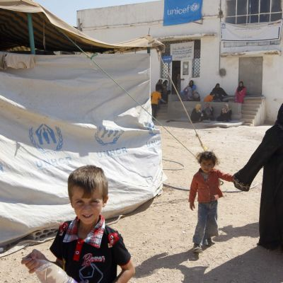 Syriska flyktingar i ett Jordanskt flyktingläger.