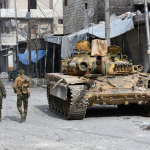 Syriska soldater i ett återerövrat område i östra Aleppo. Ett foto från Syriens statliga nyhetsbyrå (SANA) 12.12.2016
