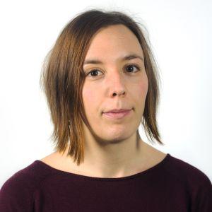 Porträtt av Åsa Callmer, forskare vid KTH. Hon har brunt kort hår och bruna ögon.