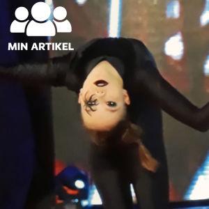 Dansare böjer sig bakåt med händerna utsträckta.