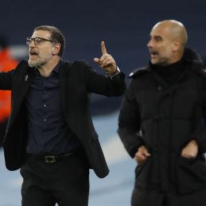 Tränarna Slaven Bilic i West Bromwich (till vänster) och Pep Guardiola i Manchester City har haft en tung höst.