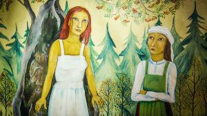Kaksi piirrettyä naishahmoa, toinen punatukkainen, toinen päähine päässä, metsämaisemaa, noitavainomuseossa Kristiinankaupungissa