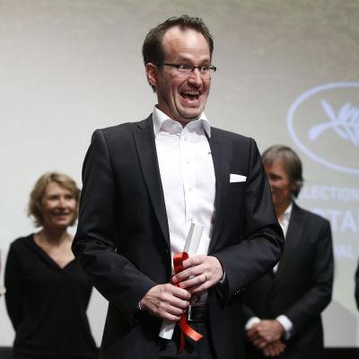 Regissören Juho Kuosmanen i Cannes