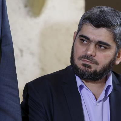 Mohammed Alloush, chefsförhandlare för HNC, under Genèvesamtalen 18.3.2016