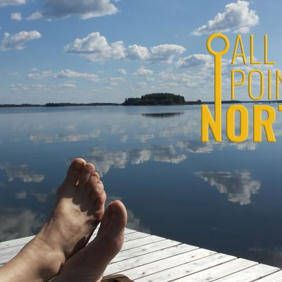Photo of a seaside dock featuring the All Points North podcast logo.