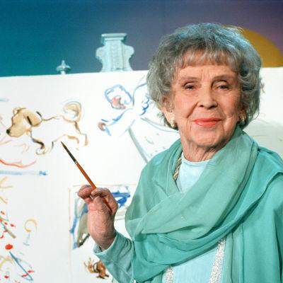 Kylli-täti maalaa jouluista satua 1995.