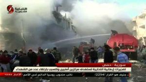 Skärmdump från den syriska tv-kanalen Al-Ikhbariya Al-Souriya visar attentatsplatsen i Homs 25.2.2017