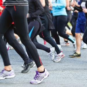 Människor som springer