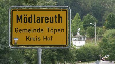 Vägskylt i Mödlareuth